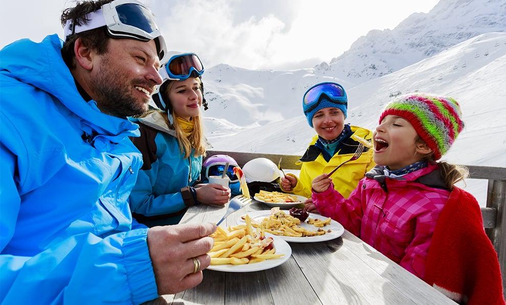 Ski Family Enjoying A Meal
